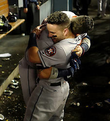 October 25, 2017 - Los Angeles, California, U.S. - Houston Astros' Marwin Gonzalez hugs teammate Jose Altuve during game two of a World Series baseball game against the Los Angeles Dodgers at Dodger Stadium on Wednesday, Oct. 25, 2017 in Los Angeles. Houston Astros won 7-6 in 10 innings. (Photo by Keith Birmingham, Pasadena Star-News/SCNG) (Credit Image: © San Gabriel Valley Tribune via ZUMA Wire)