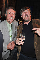 Left to right, ERIC IDLE and STEPHEN FRY at a party to celebrate the publication of Joseph Anton by Sir Salman Rushdie held at The Collection, 264 Brompton Road, London SW3 on 14th September 2012.