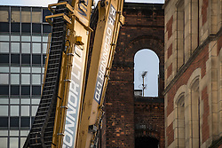 © Licensed to London News Pictures . FILE PICTURE DATED 27/11/2016 . Manchester , UK . GV of demolition equipment outside a gutted building on the corner of Faulkner Street and Nicholas Street in Manchester's China Town , following a fatal fire as this evening (5th December 2016) Greater Manchester Police have launched a murder investigation into the deaths of James Evans (57) and Wayne Bardsley (51) , who died at the scene . Photo credit : Joel Goodman/LNP