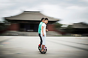 "A Chinese boy drives his segway in the city centre of Datong, China, July 23, 2014.<br />   <br /> This picture is part of the series ""Urban Chinese Streets"", a journey on the streets of Chinese cities to discover their modern citizens and habits.       <br /> <br /> © Giorgio Perottino"