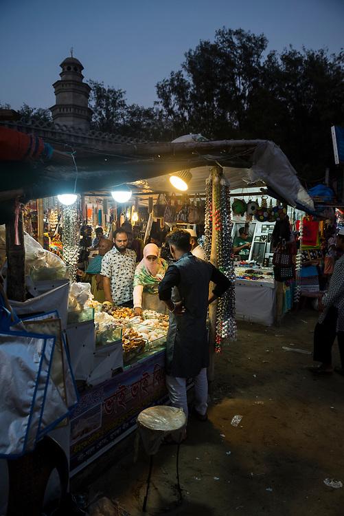 Cox's Bazar, Bangladesh - October 27, 2017: A woman shops for seashells at a beachside market in Cox's Bazar.