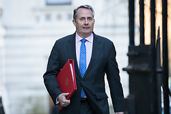 © Licensed to London News Pictures. 18/12/2017. London, UK. Secretary of State for International Trade Liam Fox arrives on Downing Street for a special Cabinet meeting in which ministers are expected to discuss the Brexit end deal. Photo credit: Rob Pinney/LNP