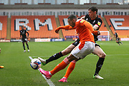 Blackpool forward Keshi Anderson (8) clears from Lincoln City midfielder Conor McGrandles (18) during the EFL Sky Bet League 1 match between Blackpool and Lincoln City at Bloomfield Road, Blackpool, England on 3 October 2020.