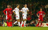 Photograph: Scott Heavey.<br />Euro 2004 Group 9 Qualifying match.<br />Wales v Serbia and Montenegro. 11/10/2003.<br />A dejected Welsh team after Serbia take the lead again