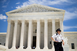 June 26, 2017 - Washington, District of Columbia, U.S. - A U.S. Supreme Court police officer stands outside the Supreme Court. The U.S. Supreme Court on Monday announced that it has decided to allow President Donald Trump's controversial revised travel ban to go into effect in most instances and will review it in fall. (Credit Image: © Ting Shen/Xinhua via ZUMA Wire)