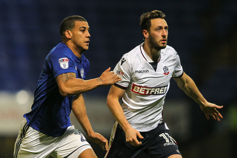 Bolton Wanderers' Will Buckley competing with Cardiff City's Lee Peltier <br /> <br /> Photographer Andrew Kearns/CameraSport<br /> <br /> The EFL Sky Bet Championship - Bolton Wanderers v Cardiff City - Saturday 23rd December 2017 - Macron Stadium - Bolton<br /> <br /> World Copyright © 2017 CameraSport. All rights reserved. 43 Linden Ave. Countesthorpe. Leicester. England. LE8 5PG - Tel: +44 (0) 116 277 4147 - admin@camerasport.com - www.camerasport.com