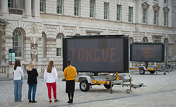 Earth Day Season 2019 <br /> Launch <br /> 16th April 20199 <br /> press photo call <br /> <br /> The artist : Justin Brice Guariglia <br /> <br /> Nine large solar powered led signs take over Somerset House courtyard in major new installation tackling climate change. <br /> <br /> Somerset House launches their Earth Day Season 2019 with 'REDUCE SPEED NOW!' from American artist Justin Brice Guariglia <br /> <br /> REDUCE SPEED NOW! a major courtyard installation, opens at Somerset House in London, launching of a fortnight of installations and events exploring creative responses to climate change. Formed of nine large solar-powered LED signs usually seen on motorways, the installation brings together the critical voices of international activists, poets and philosophers to address the global ecological crisis.<br /> <br /> Photograph by Elliott Franks