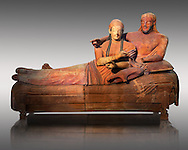 6th century BC Etruscan Sarcophagus known as The Sarcophagus of the Spouses, the in sculpted in clay by the sculptors of Caere, 520-510 BC, Louvre Museum, Paris.  Grey Background. To license for Advertising usage contact The Louvre Paris .<br /> <br /> If you prefer to buy from our ALAMY PHOTO LIBRARY  Collection visit : https://www.alamy.com/portfolio/paul-williams-funkystock/vatican-museums-etruscan.html - Type -       Louvre     - into the LOWER SEARCH WITHIN GALLERY box.<br /> <br /> Visit our ETRUSCAN PHOTO COLLECTIONS for more photos to download or buy as wall art prints https://funkystock.photoshelter.com/gallery-collection/Pictures-Images-of-Etruscan-Historic-Sites-Art-Artefacts-Antiquities/C0000GgxRXWVMLyc