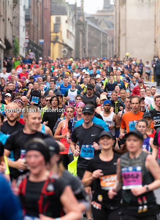 Edinburgh, Scotland, UK. 26 May, 2019. Many runners taking part in the Edinburgh Marathon Festival Marathon run down the Royal Mile in Edinburgh's Old Town towards Holyrood.