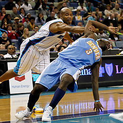 January 6, 2012; New Orleans, LA, USA; New Orleans Hornets point guard Jarrett Jack (2) fouls Denver Nuggets point guard Ty Lawson (3) during the second half of a game at the New Orleans Arena. The Nuggets defeated the Hornets 96-88.  Mandatory Credit: Derick E. Hingle-US PRESSWIRE