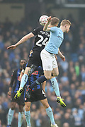 Rotherham United forward Michael Smith (24) challenges 17 Kevin De Bruyne for Manchester City during the The FA Cup 3rd round match between Manchester City and Rotherham United at the Etihad Stadium, Manchester, England on 6 January 2019.