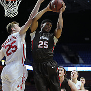 Jason Massey, (right), Brown, rebounds while challenged by Connor McClenaghan, Marist, during the Marist vs Brown Men's College Basketball game in the Hall of Fame Shootout Tournament at Mohegan Sun Arena, Uncasville, Connecticut, USA. 22nd December 2015. Photo Tim Clayton