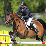 Beat Mandli riding Zander in action during the $100,000 Empire State Grand Prix presented by the Kincade Group during the Old Salem Farm Spring Horse Show, North Salem, New York,  USA. 17th May 2015. Photo Tim Clayton