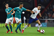 Doninic Solanke of England U21's on the attack gets away from Felix Uduokhai of Germany U21's during the U21 International match between England and Germany at the Vitality Stadium, Bournemouth, England on 26 March 2019.