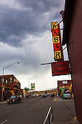 Restaurant sign in Gardiner, Montana, the north west gateway town to Yellowstone National Park, with a rainstorm commencing in the background.