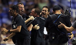 Derby County manager Frank Lampard (right), goalkeeping coach Shay Given (second left) and the rest of the bench celebrate after Tom Lawrence (not pictured) scores his side's second goal of the game during the Sky Bet Championship match at the Madejski Stadium, Reading.