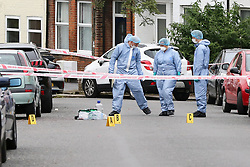 © Licensed to London News Pictures. 19/06/2019. London, UK. Forensic officers and evidence markers on Wellbeck Road, Barnet, North London where three men were found to be suffering stab injuries on Tuesday 18 June 2019, just before 11pm. A man in his 30s was treated at the scene, but he was pronounced dead shortly after midnight. Two other men – one in his 20s and one in his 30s were taken to hospital for treatment.  Photo credit: Dinendra Haria/LNP