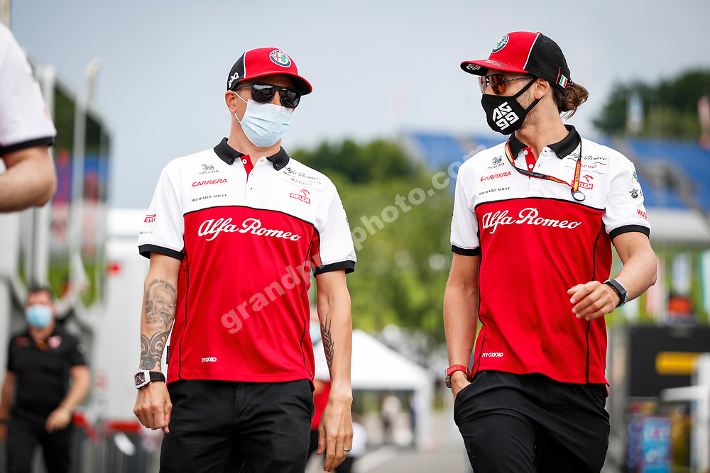 Alfa Romeo-Ferrari drivers Kimi Raikkonen and Antonio Giovinazzi  with masks before the 2020 Austrian Grand Prix at the Red Bull Ring in Spielberg.  © Copyright: FIA Pool Image for Editorial Use Only