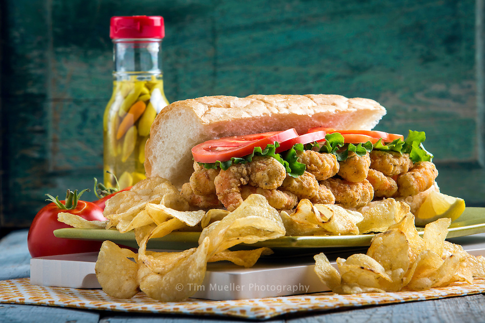 Shrimp Po-Boys are distinguised by their baguette-like New Orleans French bread, known for its crust and fluffy center.