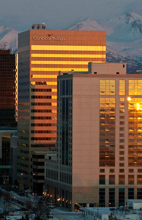 Alaska, Anchorage  city  downtown in winter has an early sunset  that lights up Conoco Phillips tower .
