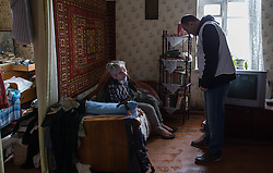 Doctor Kachatur Malakyan and nurse Andrei Bogma of MSF provide home visits to Valentina, 76, and Nikolai Shevchuck, 77, in their home in Debalseve. Nikola suffers from chronic cardia disease and is bed-ridden. He relies on his wife to take care of him. MSF provides vital home care to patients like Nikolai who are house-bound and have stopped receiving medical care in the embattled eastern Ukranian town.