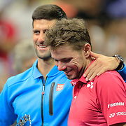 2016 U.S. Open - Day 14  Novak Djokovic of Serbia and Stan Wawrinka of Switzerland share a moment during the trophy presentation after Stan Wawrinka of Switzerland won the Men's Singles Final on Arthur Ashe Stadium on day fourteen of the 2016 US Open Tennis Tournament at the USTA Billie Jean King National Tennis Center on September 11, 2016 in Flushing, Queens, New York City.  (Photo by Tim Clayton/Corbis via Getty Images)
