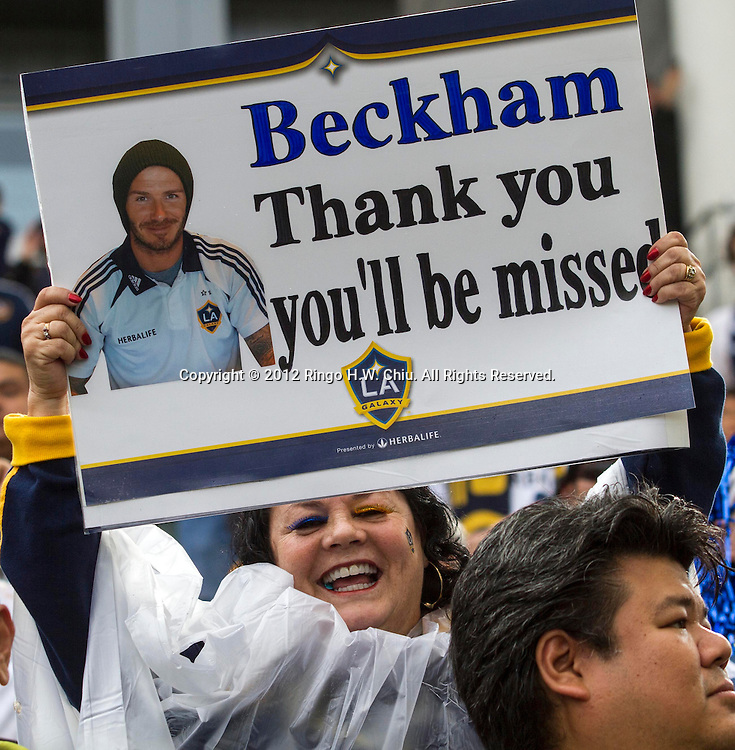 A fan of Los Angeles Galaxy star David Beckham holds a sign in the Major League Soccer (MLS) Cup final at the Home Depot Center on December 1, 2012 in Carson, California. The Galaxy defeated Houston Dynamo 3-1 to win the LMS Cup Championship. Beckham will be leaving the team after the game. He joined the L.A. Galaxy back on January 11, 2007, when he signed a 5-year contract worth $32.5million. He has played in over 98 games during his six season stint with the Galaxy and just last season was named an MLS all-star while notching a career best 15 assists in MLS play. (Photo by Ringo Chiu/ PHOTOFORMULA.com).