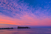 Le Rocher Percé or Percé Rock in the Atlantic Ocean at sunset<br />Percé<br />Quebec<br />Canada