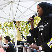 Tens of thousands took to the streets in Central London taking part in the the Global Climate Strike, September 20th 2019, London, United Kingdom.  Zamzam Ibrahim from the NUS adresses the crowd. The day of strike for the climate was a global event with millions taking part across the globe. The strike was inspired by Greta Thunberg, a Swedish school girl who started the first school strike for the climate. Her action inspired school children across the world to go on strike demanding radical climate change policies to save their future. On September 20th adults aand children alike went out on strike to demand radical political change and climate justice. The day included speeches and a march through central London.