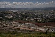 Itabira, Minas Gerais, Brazil, 31 Jan 2019:<br /> Mine of Vale S.A. property near the urban area of Itabira (100 km from Belo Horizonte), a city where Vale S.A. was created in the 1940s by the then president Getúlio Vargas (in 1997, it was privatized), is a laboratory for the exploitation of large scale iron ore and example of contradictions of the mineral industry.<br /> One of the municipalities that collects the most mining taxes in the State of Minas Gerais.<br /> The changes in geography caused by mining are visible throughout the city. Entire neighborhoods have already been removed.<br /> Photo: Avener Prado