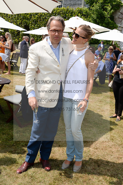 The EARL OF MARCH and his daughter LADY ALEXANDRA GORDON-LENNOX at the Cartier 'Style et Luxe' part of the Goodwood Festival of Speed, Goodwood House, West Sussex on 14th July 2013.