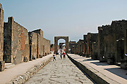 General view of Via di Mercurio and Arco Onorario at the ruins at Pompeii, Campania, Italy under the Vesuvius volcano, July 2006