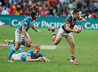 HONG KONG, HONG KONG : Rowan Varty of Hong Kong tries to run away from defenders for England, in England's  42-7 win in the Bowl Final, at the Hong Kong Rugby Sevens, shown in Hong Kong on Sunday, 24 March, 2013.