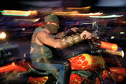 Masked Biker, Sturgis, SD. 1993<br /> <br /> Limited Edition Print from an edition of 50. Photo ©1993 Michael Lichter.
