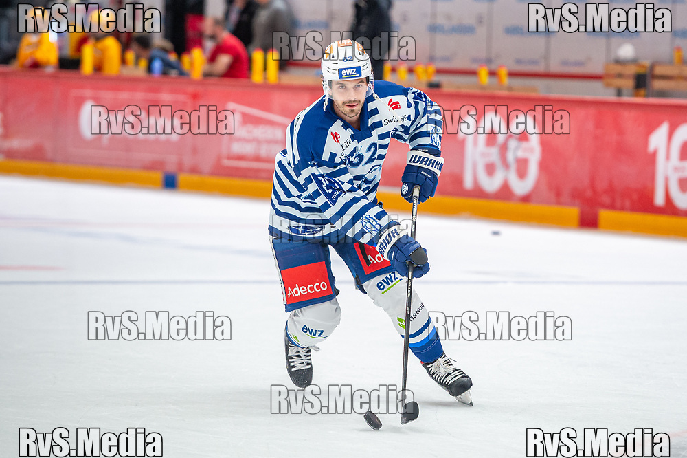 LAUSANNE, SWITZERLAND - OCTOBER 01: Denis Malgin #62 of ZSC Lions warms up prior the Swiss National League game between Lausanne HC and ZSC Lions at Vaudoise Arena on October 1, 2021 in Lausanne, Switzerland. (Photo by Monika Majer/RvS.Media)