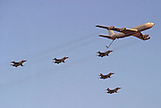 5 Israeli Air force Fighter jet F16 being refuelled by a Boeing 707 in flight