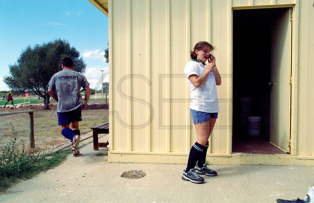 Tecnico team captain  talking with her boyfriend on the phone before watching a male match.