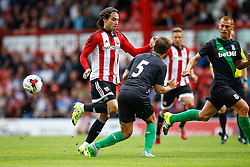 Marc Muniesa of Stoke City intercepts Jota of Brentford run - Mandatory by-line: Jason Brown/JMP - Mobile 07966 386802 25/07/2015 - SPORT - FOOTBALL - Brentford, Griffin Park - Brentford v Stoke City - Pre-Season Friendly