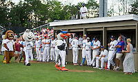 """The Eastern All Star team gets a pep talk from the """"Mascots"""" prior to the start of the New England Collegiate All Star game Sunday evening at Robbie Mills Field.   (Karen Bobotas/for the Laconia Daily Sun)"""