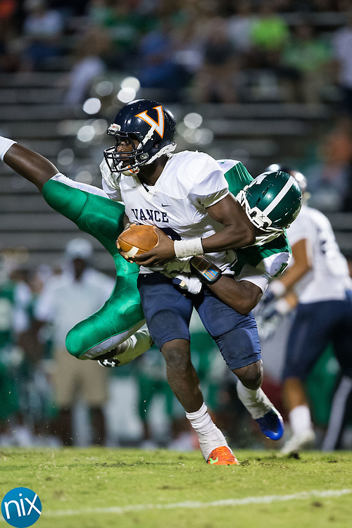 Kingsley Ifedi (12) of the Vance Cougars is tackled by Najee Williams (88) of the A.L. Brown Wonders during second half action at A.L. Brown High School on September 30, 2016 in Kannapolis, North Carolina.  The Wonders defeated the Cougars 24-21.  (Brian Westerholt/Special to the Tribune)
