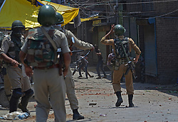 July 8, 2017 - India - Pro freedom protesters clash with Indian paramilitary soldiers in old city area of Srinagar the summer capital of Indian controlled Kashmir on July 08, 2017. Government authorities imposed strict curfew across Kashmir on the first death anniversary of top rebel Hizbul Mujahideen commander Burhan Wani to thwart any pro freedom demonstration. Burhan was killed by Indian security forces in Bamdoora ,Kokernag in south Kashmir on July 08. 2016 triggering unrest across Kashmir which left more than hundred civilians dead and thousands injured. (Credit Image: © Faisal Khan/Pacific Press via ZUMA Wire)