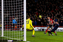 George Baldock of Sheffield United shoots at goal past Aaron Cresswell of West Ham United - Mandatory by-line: Robbie Stephenson/JMP - 10/01/2020 - FOOTBALL - Bramall Lane - Sheffield, England - Sheffield United v West Ham United - Premier League