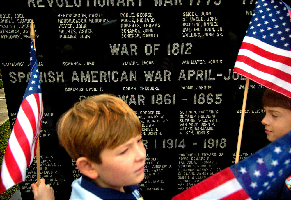 Cub Scouts from Pack 331 (Den #8) Devin Foran (left) and Adam Marciszewski (right) take a moment at one of the memorials created for Holmdel veterans during a Veteran's Park memorial service held at Phillips Park in Holmdel, New Jersey on November 8, 2008.  The memorial service was held with Holmdel's adopted unit, Alpha Company, 1st Brigade Special Troops Battalion, 1st Brigade Combat Team, 82nd Airborne Division were present for the wreath presentation.