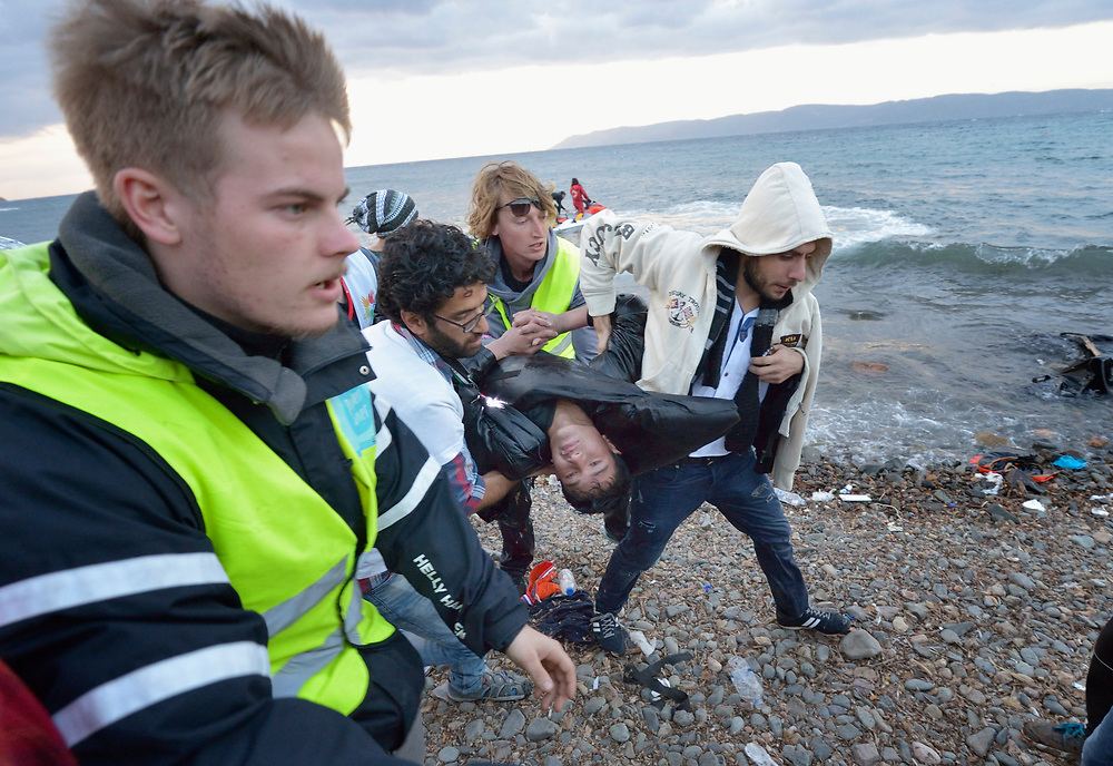 An Afghan refugee was pulled from the water by Spanish lifeguards and rushed to a medical tent on a beach near Molyvos, on the Greek island of Lesbos, on October 30, 2015. He was on a boat full of refugees that capsized on its way from Turkey. The boat was provided by Turkish traffickers to whom the refugees paid huge sums to arrive in Greece. Although his body temperature had dropped to almost 80 degrees, the volunteer medical team on the beach kept him alive, and he was later transported to a hospital in Mytilene. He was expected to survive.