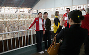 Tourists pose by Pit 1 at Qin Museum, exhibition halls of Terracotta Warriors, China