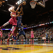 Katie Douglas, (left), Connecticut Sun, fouls Damiris Dantas, Minnesota Lynx, during the Connecticut Sun Vs Minnesota Lynx, WNBA regular season game at Mohegan Sun Arena, Uncasville, Connecticut, USA. 27th July 2014. Photo Tim Clayton