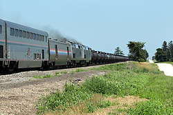 Just south of Wataba Illinois, a Burlington Northern Santa Fe Freight Train travels towards Galesburg and it meets an Amtrak passenger on the 2nd set of rails headed north