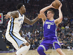 December 31, 2017 - Sacramento, CA, USA - The Sacramento Kings' Bogdan Bogdanovic (8) looks to make a pass against the Memphis Grizzlies' Jarell Martin (1) on Sunday, Dec. 31, 2017, at the Golden 1 Center in Sacramento, Calif. (Credit Image: © Hector Amezcua/TNS via ZUMA Wire)