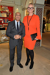 LORD VERJEE and ILIANE OGILVIE-THOMPSON at the London debut of Nest - an organisation to promote peace and prosperity in partnership with artisans worldwide, held at Thomas Goode & Co, South Audley Street, London on 4th November 2014.