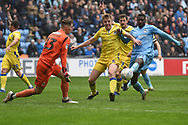 Coventry City striker Amadou Bakayoko (21) try to get a shot away under pressure from Bristol Rovers defender Tony Craig (5) during the EFL Sky Bet League 1 match between Coventry City and Bristol Rovers at the Ricoh Arena, Coventry, England on 7 April 2019.